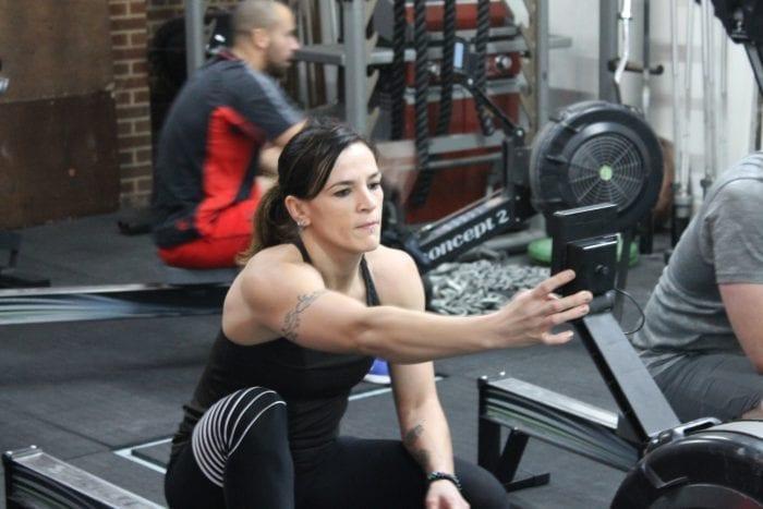 member using rowing machine